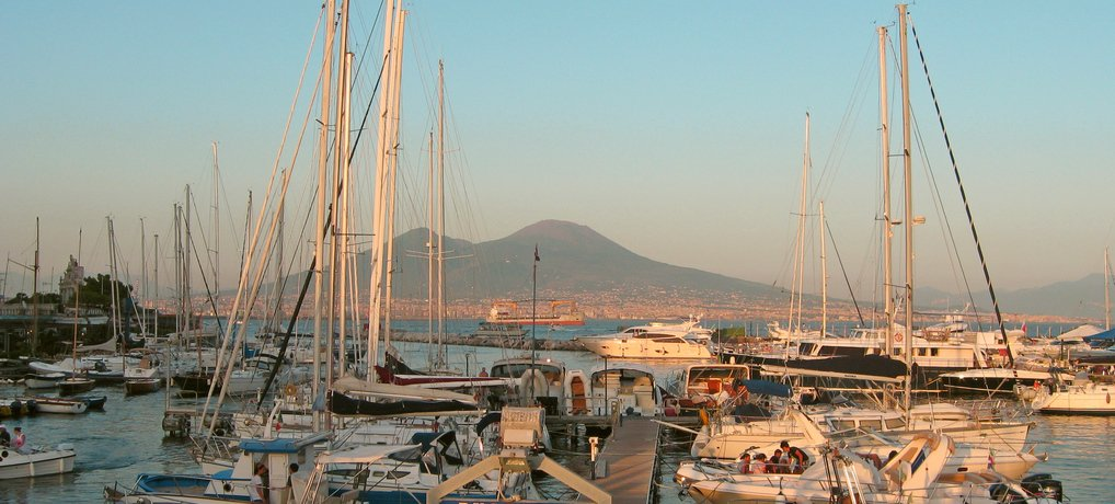 View to Mount Vesuvius from the harbor Santa Lucia in Naples